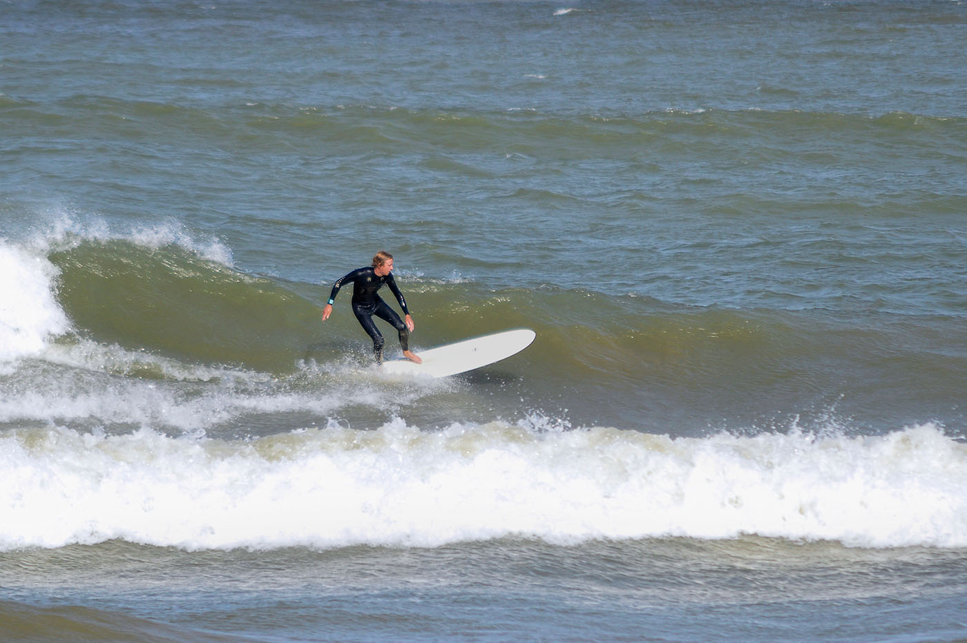 Ryan of Third Coast Surf Shop surfing Lake Michigan photo by Nowicki